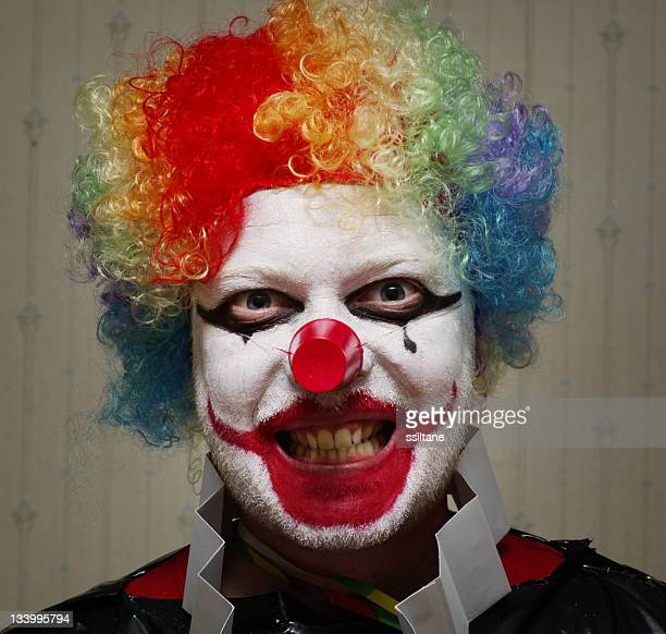 evil joker clown - scary clown makeup stock photos and pictures