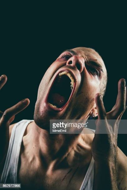 evil man - insanity stock pictures, royalty-free photos & images