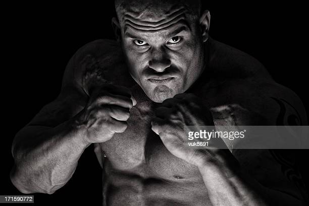 evil of the darkness - belly punching stock pictures, royalty-free photos & images