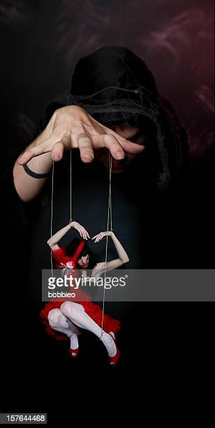 evil puppeteer - puppet stock pictures, royalty-free photos & images