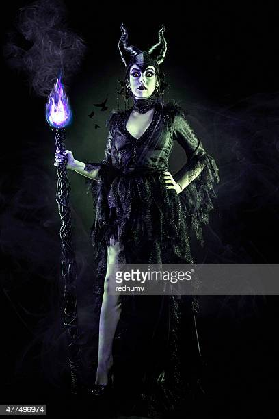 Evil Sorceress in Black Gown and Magic Staff