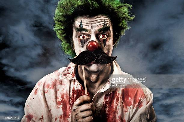 evil vampire clown and mustache - scary clown makeup stock photos and pictures