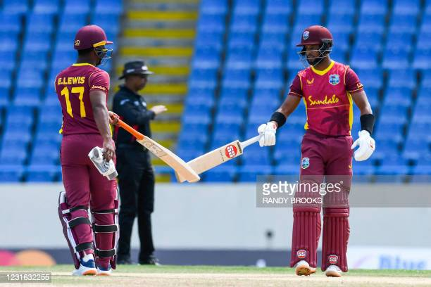 Evin Lewis and Shai Hope of West Indies 50 runs partnership during the 1st ODI match between West Indies and Sri Lanka at Vivian Richards Cricket...