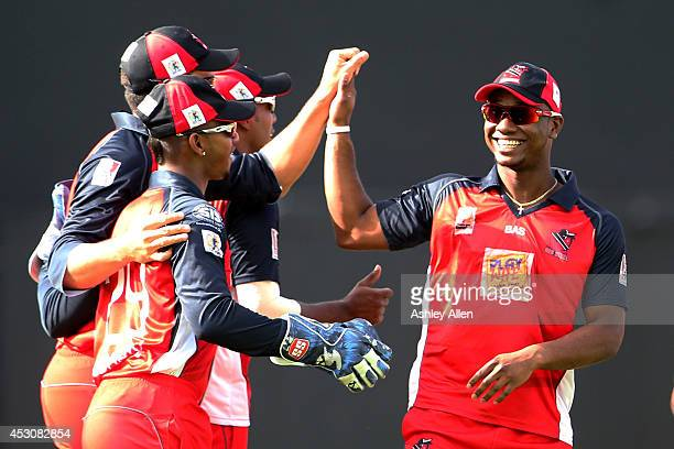 Evin Lewis celebrates with his team mates during a match between St Lucia Zouks and The Trinidad and Tobago Red Steel as part of week 4 of the...