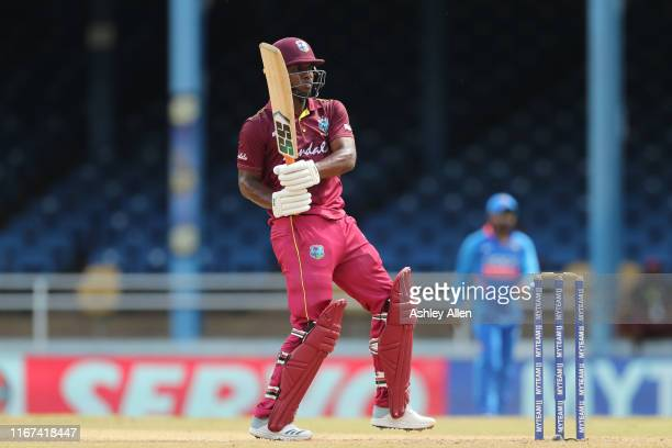 Evin Lewis of the West Indies hits a boundary during the second MyTeam11 ODI between the West Indies and India at the Queen's Park Oval on August 11,...
