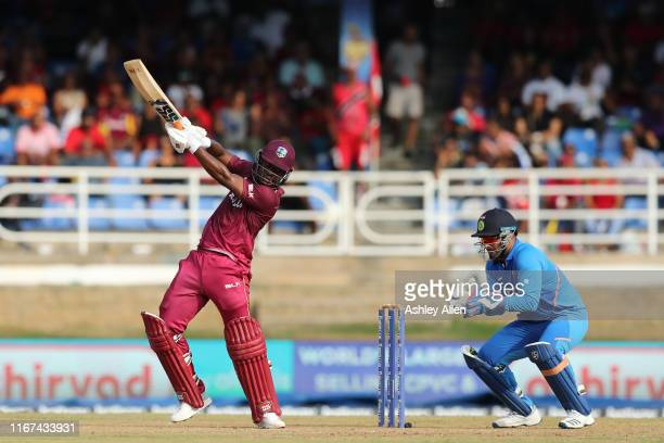 Evin Lewis of the West Indies hits four as India's Rishabh Pant looks on during the second MyTeam11 ODI between the West Indies and India at the...