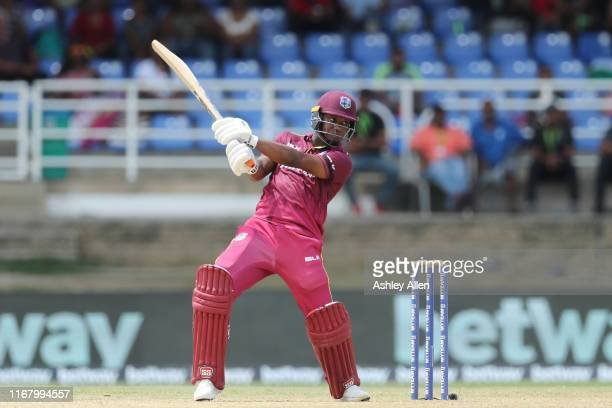 Evin Lewis of the West Indies hits four during the third MyTeam11 ODI between the West Indies and India at the Queen's Park Oval on August 14, 2019...