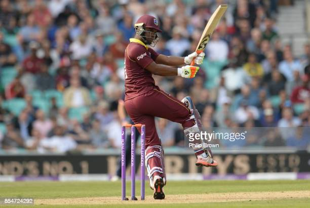 Evin Lewis of the West Indies hits out during the 4th Royal London one-day international cricket match between England and the West Indies at the KIA...
