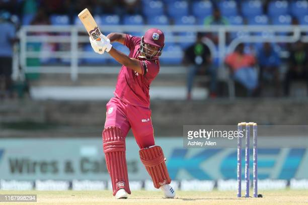 Evin Lewis of the West Indies hits through the offside during the third MyTeam11 ODI between the West Indies and India at the Queen's Park Oval on...