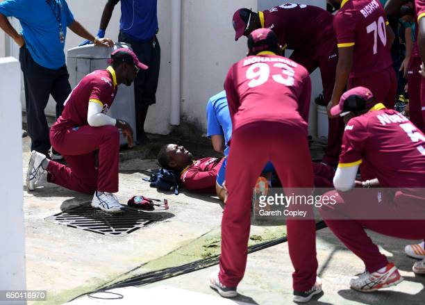 Evin Lewis of the West Indies lies on the ground after injurying himself while fielding on the boundary during the 3rd One Day International between...