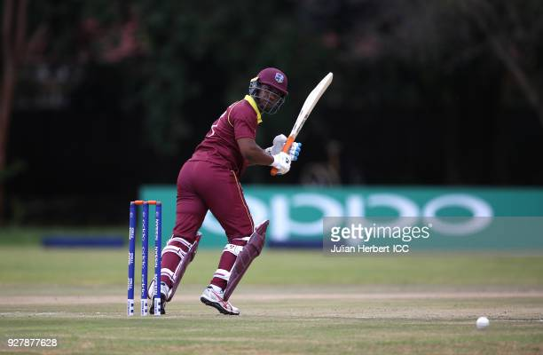 Evin Lewis of The West Indies scores runs during The ICC Cricket World Cup Qualifier between The West Indies and The UAE at The Old Hararians Ground...