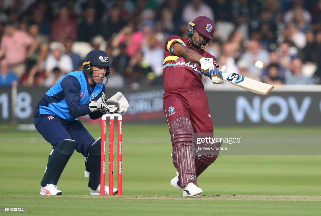 Evin Lewis of West Indies bats as wicket-keeper Luke Ronchi of the ICC World XI looks on during the Hurricane Relief T20 match between the ICC World XI and West Indies at Lord's Cricket Ground on May 31, 2018 in London, England.