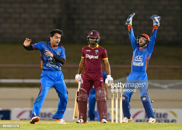 Evin Lewis of West Indies dismiss lbw by Rashid Khan Arman of Afghanistan during the 2nd ODI match between West Indies and Afghanistan at Darren...