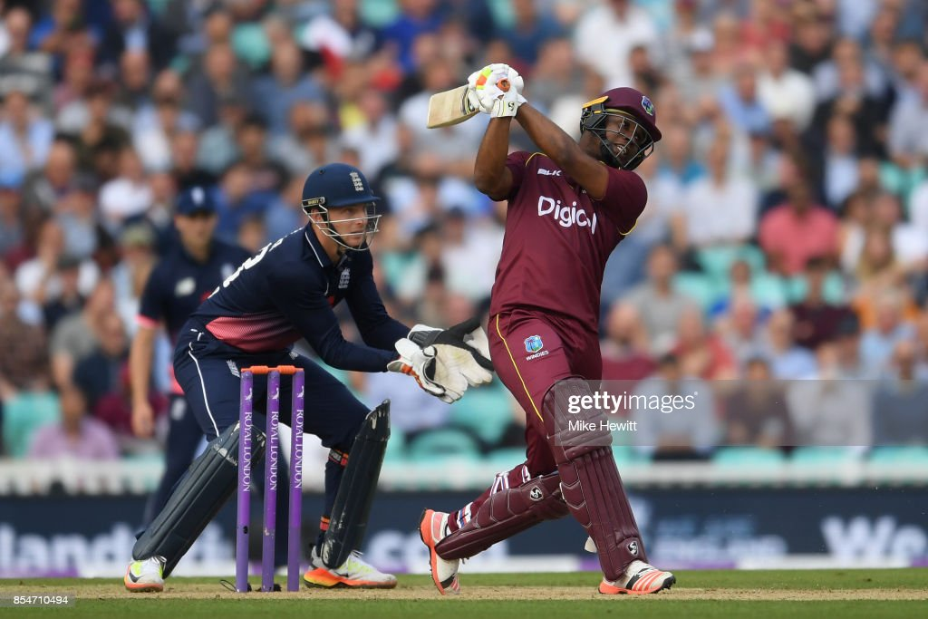 Evin Lewis of West Indies hits a six as wicketkeeper Jos Buttler of England looks on during the 4th Royal London One Day International between England and West Indies at The Kia Oval on September 27, 2017 in London, England.
