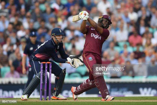 Evin Lewis of West Indies hits a six as wicketkeeper Jos Buttler of England looks on during the 4th Royal London One Day International between...