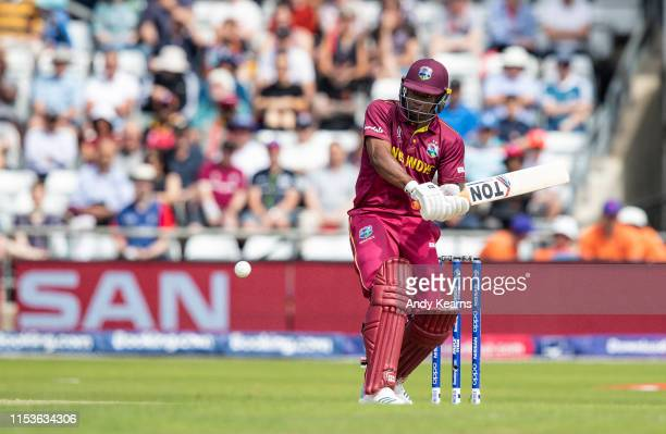 Evin Lewis of West Indies hits the ball over the boundary for six during the Group Stage match of the ICC Cricket World Cup 2019 between Afghanistan...