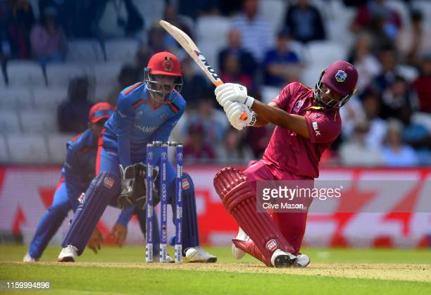 Evin Lewis of West Indies in action batting as Ikram Ali Khil of Afghanistan looks on during the Group Stage match of the ICC Cricket World Cup 2019...