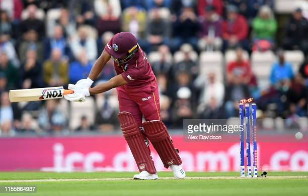 Evin Lewis of West Indies is bowled by Chris Woakes of England during the Group Stage match of the ICC Cricket World Cup 2019 between England and...