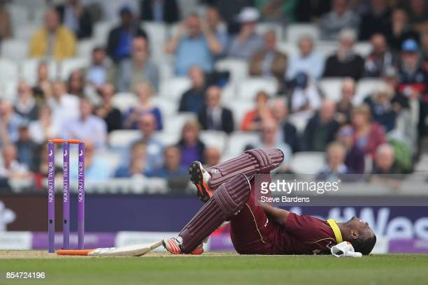 Evin Lewis of West Indies is injured in the ankle during the 4th Royal London One Day International between England and West Indies at The Kia Oval...