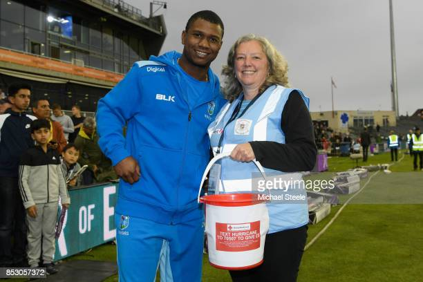 Evin Lewis of West Indies with Liz a volunteer collecting on behalf of the British Red Cross for the Hurricane appeal during the third Royal London...