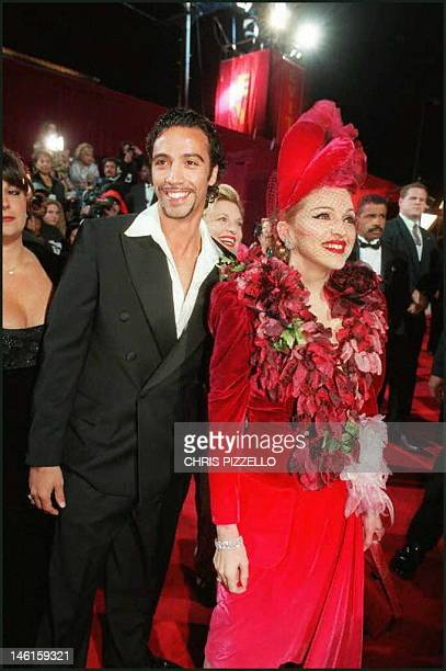 Evita star Madonna and Carlos Leon father of their infant daughter arrive for the film's premiere Saturday Dec 14 at the Shrine Auditorium in Los...