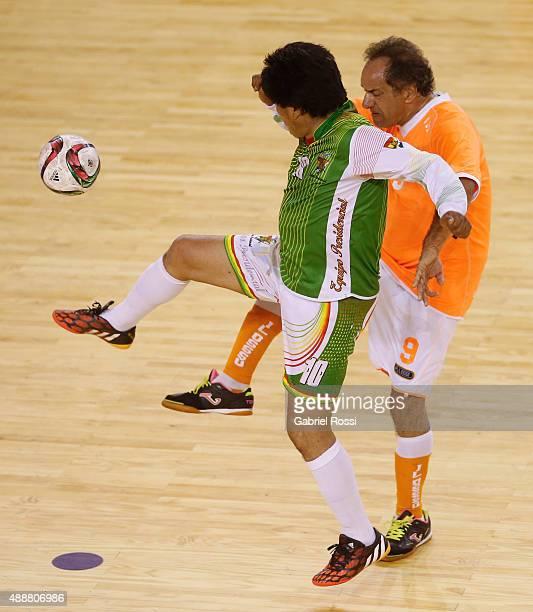 "Evo Morales President of Bolivia fights for the ball with Daniel Scioli Governor of Buenos Aires during a Copa Juana Azurduy match at Villa La ""Ñata..."