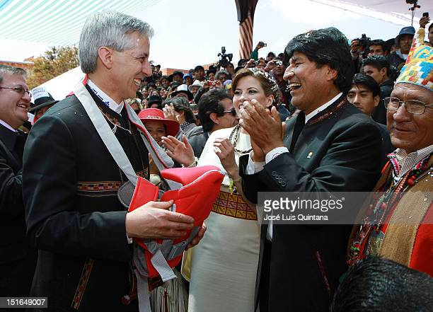 Evo Morales President of Bolivia makes a gift to Alvaro Garcia Linera vice president of Bolivia and Claudia Fernandez during the wedding ceremony at...