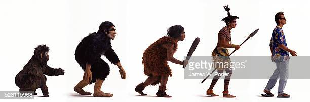 evolution of man - monkey man stock pictures, royalty-free photos & images