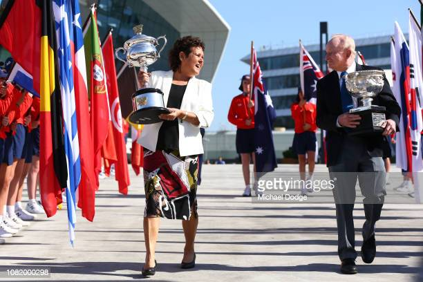 Evonne Goolagong Cawley and Rod Laver arrive with the Daphne Akhurst Memorial Cup and the Norman Brookes Challenge Cup during the Australian Open...