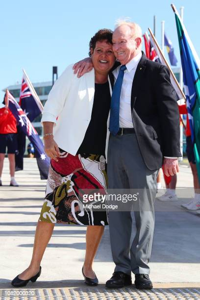 Evonne Goolagong Cawley and Rod Laver pose with the Daphne Akhurst Memorial Cup and the Norman Brookes Challenge Cup during the Australian Open...