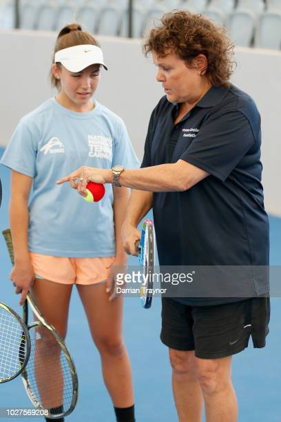 Evonne Goolagong Cawley gives some coaching advice to a young tennis player during day 1 of the National Indigenous Tennis Carnival at Darwin...