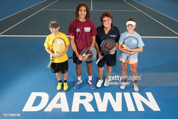 Evonne Goolagong Cawley poses for a photo with young tennis players during day 1 of the National Indigenous Tennis Carnival at Darwin International...
