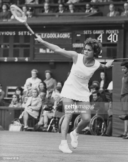Evonne Goolagong of Australia makes a backhand return to Marilyn Pryde of New Zealand during their Women's Singles Second Round match on Centre Court...