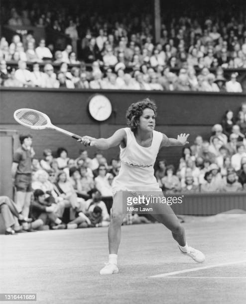 Evonne Goolagong of Australia makes a forehand return to Billie Jean King of the United States during their Women's Singles Final match on Centre...