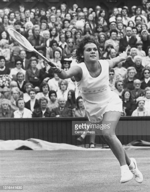 Evonne Goolagong of Australia reaches to makes a forehand return to Marilyn Pryde of New Zealand during their Women's Singles Second Round match on...