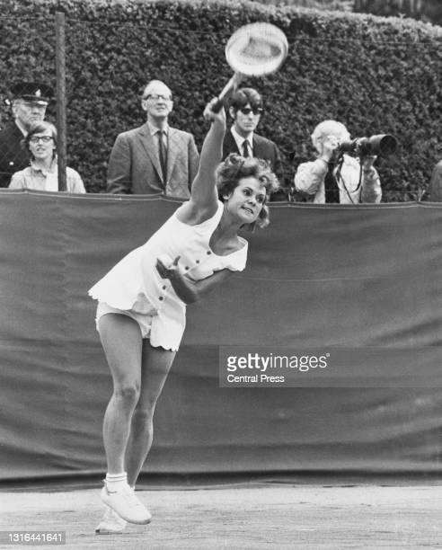 Evonne Goolagong of Australia serves to Nancy Ornstein of the United States during their Women's Singles match at the Rothmans Surrey Hard Court...