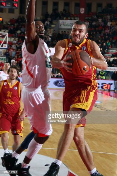 Evren Buker, #16 of Galatasaray Cafe Crown goes for the basket during the Eurocup Basketball Regular Season Game Day 2 between Bancatercas Teramo vs...