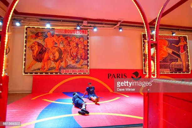 Evrik Nikoghosyan of France and Mamadassa Sylla of France relaxing backstage before the International wrestling test match between France and...