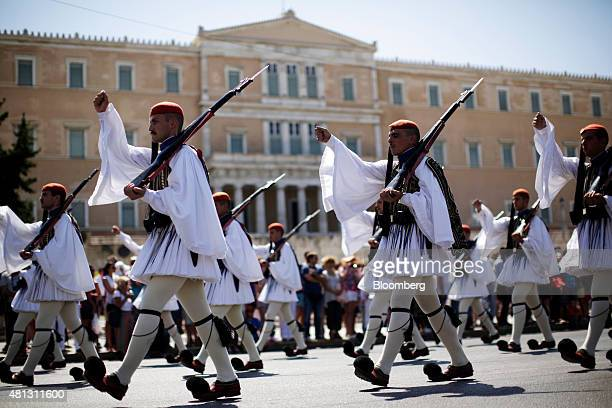 Evzone presidential guards perform the flag ceremony near the Tomb of the Unknown Soldier outside the Greek parliament on Syntagma square in Athens...
