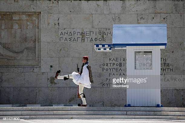 A Evzone presidential guards takes part in the flag ceremony near the Tomb of the Unknown Soldier outside the Greek parliament on Syntagma square in...