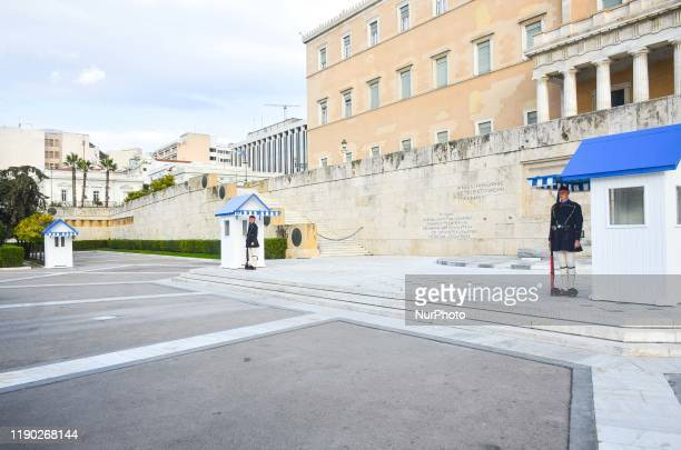 Evzones soldiers as they stand guard outside Hellenic parliament and the Tomb of the Unknown Soldier in Athens, Greece on December 23 , 2019..