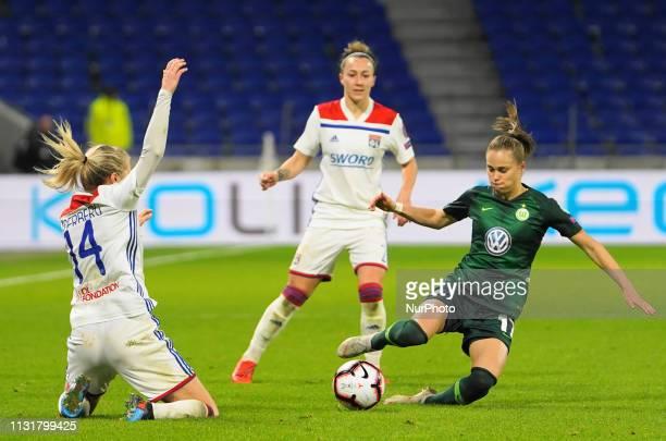 Ewa Pajor of Vfl Wolfsburg against Ada Hegerberg tackle of Olympique Lyonnais during the UEFA Women's Champions League Quarter final football match...
