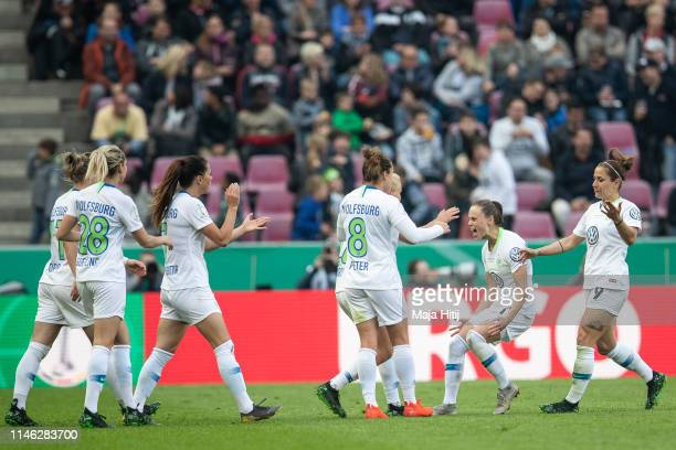 Ewa Pajor of VfL Wolfsburg celebrates with team after scoring her team's first goal during the Women's DFB Cup final match between VfL Wolfsburg and...