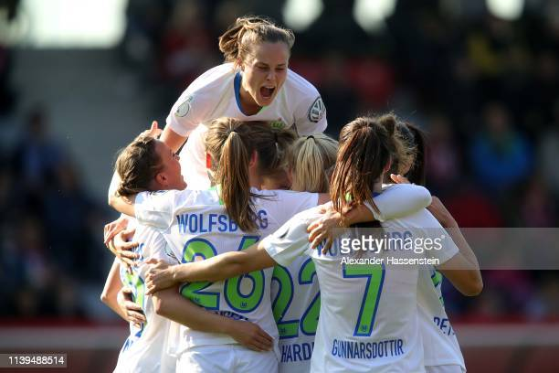 Ewa Pajor of Wolfsburg celebrate the 4th team gaol with her team mates during the DFB Cup Semi Final match between FC Bayern Muenchen and VfL...
