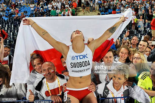 Ewa Swoboda from Poland celebrates among fans her silver medal in women's 100 meters while the IAAF World U20 Championships Day 3 at Zawisza Stadium...