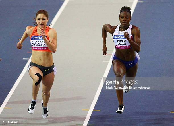 Ewa Swoboda of Poland and Dina AsherSmith of Great Britain compete in the Women's 60 metres final during the Glasgow Indoor Grand Prix at Emirates...