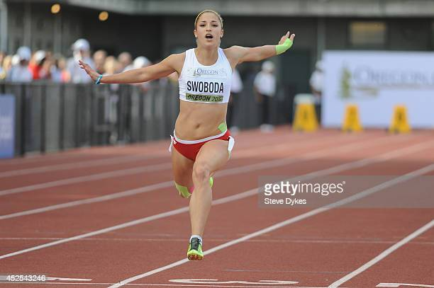 Ewa Swoboda of Poland crosses the finish line in prliminary heat of the women's 100m during day one of the IAAF World Junior Championships at Hayward...