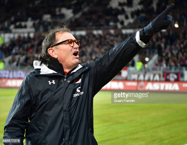 Ewald Lienen head coach of St Pauli encourages the fans during the Second Bundesliga match between FC St Pauli and Karlsruher SC at Millerntor...