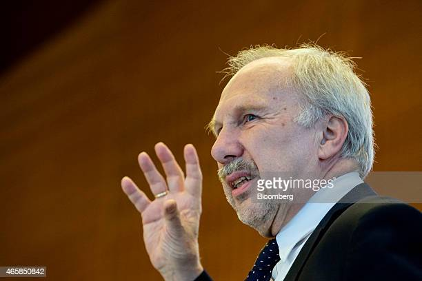 Ewald Nowotny governor of Austria's central bank gestures as he addresses the European Central Bank and its watchers conference in Frankfurt Germany...