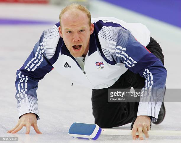 Ewan Macdonald of Great Britain gives insrtuctions during the preliminary round of the men's curling between Great Britain and Switzerland during Day...